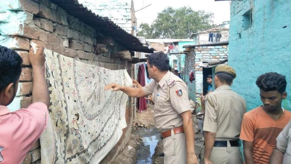 Police officials covering the defacement at Colony number 4 in Industarial Area, Chandigarh, on Saturday.