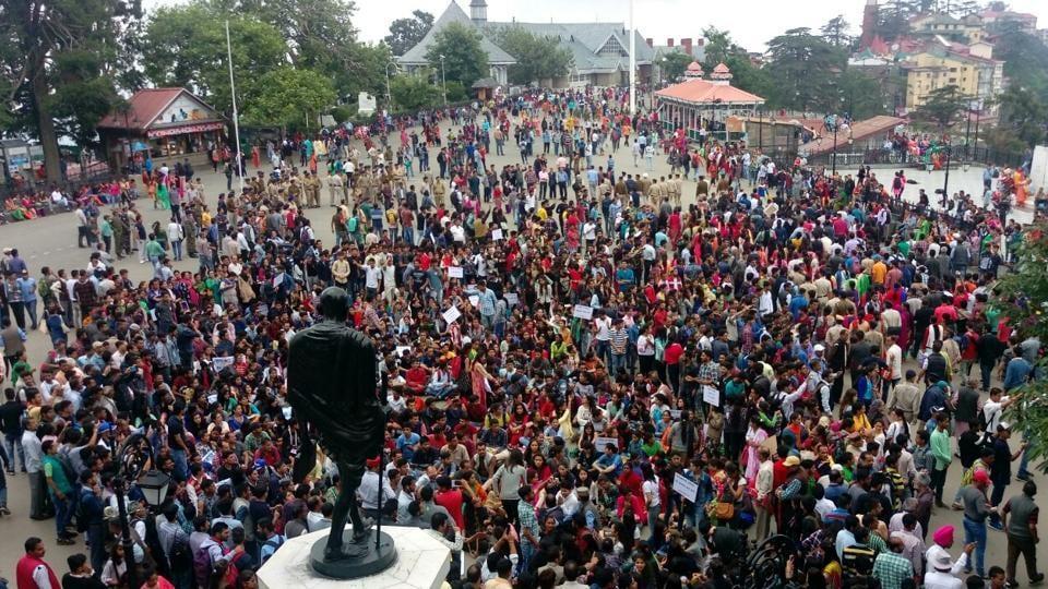 Locals protest at ridge near the statue of Mahatma Gandhi in Shimla on Saturday.