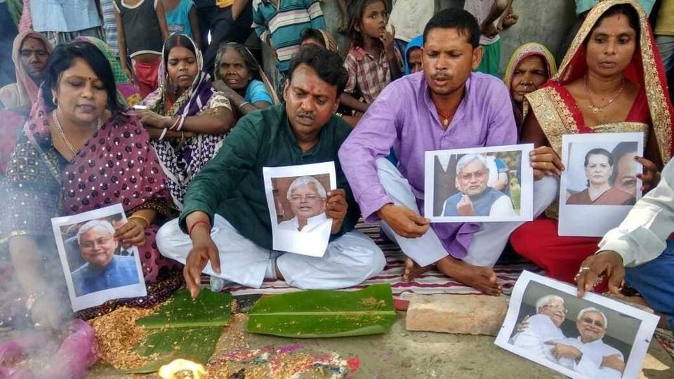 Villagers of Raghopur at a puja on Saturday to pray for RJDchief Lalu Prasad and his son Tejashwi Yadav who are facing corruption charges.