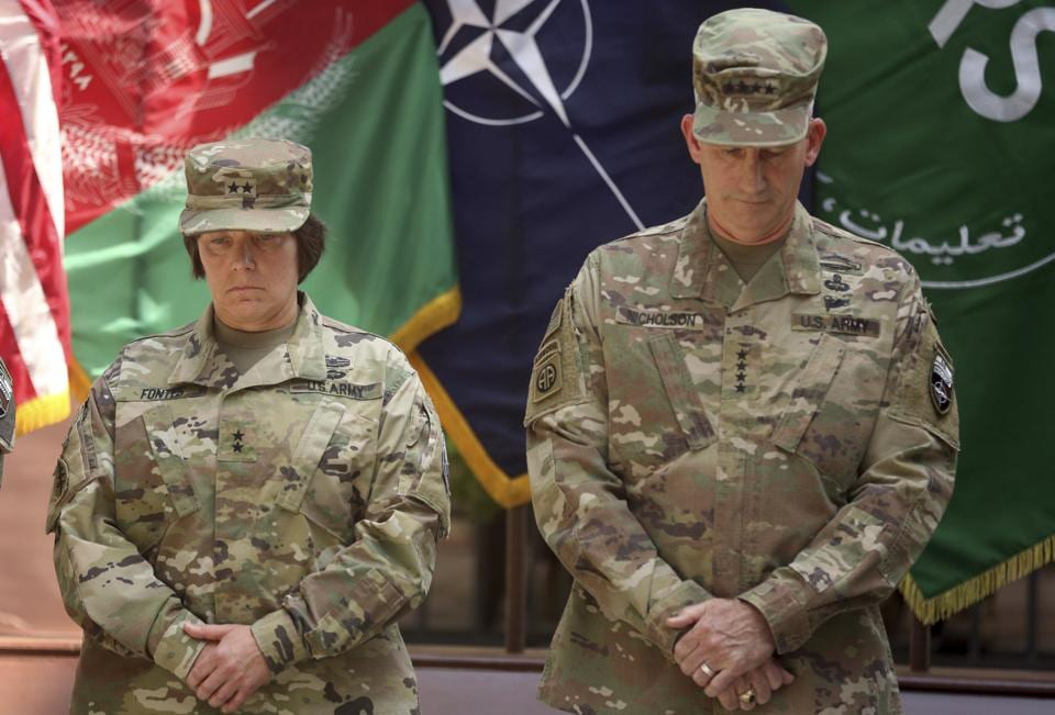 Gen John W Nicholson (right) and incoming Maj Gen Robin L Fontes attend a change of command ceremony at Resolute Support headquarters in Kabul on July 15, 2017.