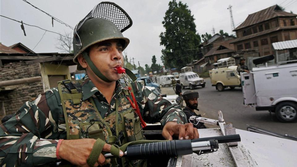 Security personnel keep vigil at the site of militant attack on Amarnath Yatris in which seven pilgrims were killed and 19 others injured, at Batango in Anantnag district of South Kashmir. (PTI)