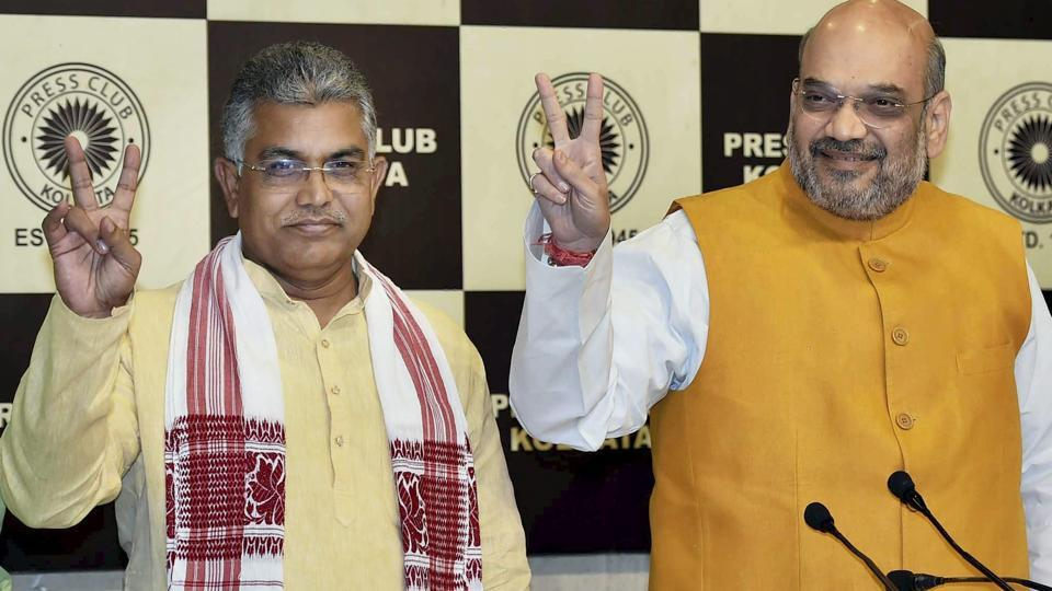 BJP president Amit Shah with state party head Dilip Ghosh at a press meet in Kolkata recently.
