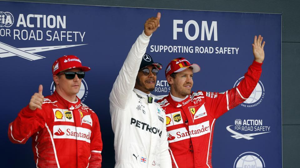 Lewis Hamilton stormed to his fifth pole position in the British Grand Prix while championship leader Sebastian Vettel was third on the grid.