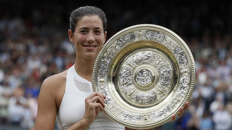 Spain's Garbine Muguruza won her maiden Wimbledon title after beating Venus Williams in the women's singles final in London on Saturday. (AP)