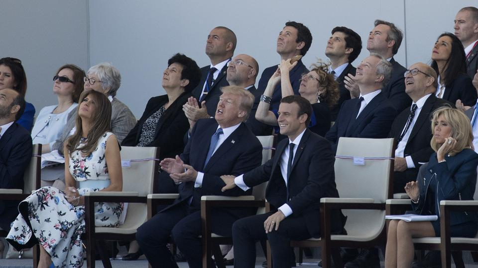 President Donald Trump, first lady Melania Trump, French President Emmanuel Macron and his wife Brigitte Macron, watch from the viewing stand during Bastille Day parade on the Champs Elysees avenue in Paris on Friday.