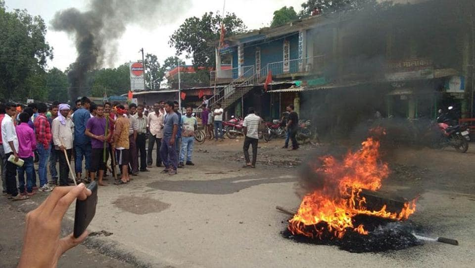 Protesters burnt tyres to block the Dhanbad-Hazaribagh highway after vandalism at a temple at Banaso in Hazaribagh district on July 14, 2017.