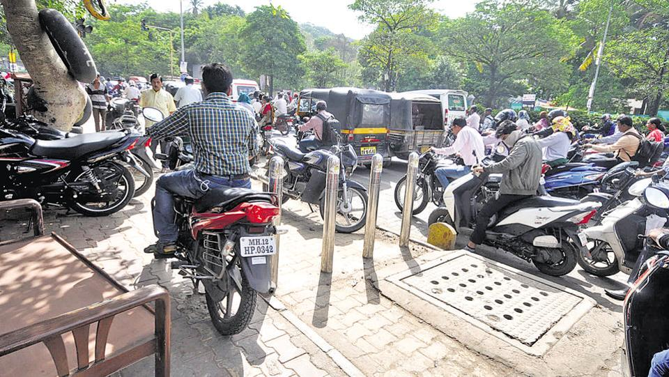 A two-wheeler rides on the footpath in the city endangering pedestrians. Niranjan Ghate is a city resident who suffered two accidents as a pedestrian.