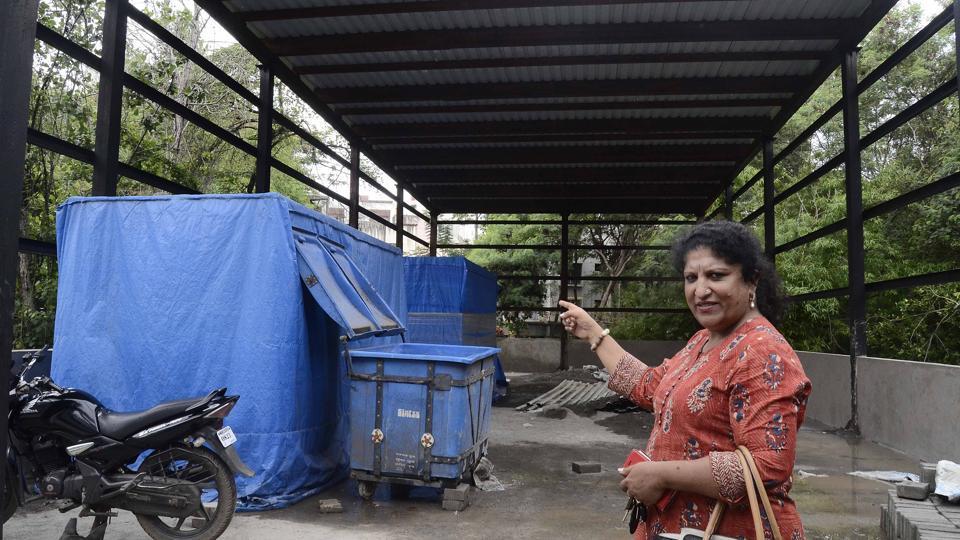Maithili Manakwad, secretary, Wanowrie Residence Forum, points to the garbage processing unit on Salunkhe Vihar road.