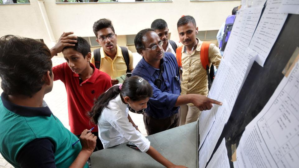 Students and parents check the short list for FYJC admission at Garware college in Pune.