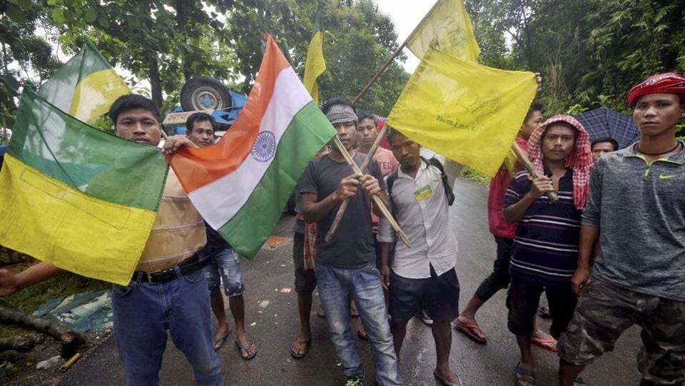 Members of the Indigenous People's Front of Tripura (IPFT) and other tribal wings go on a road and rail blockade movement to demand a separate state- Tipraland in the outskirts of Agartala. (PTI)
