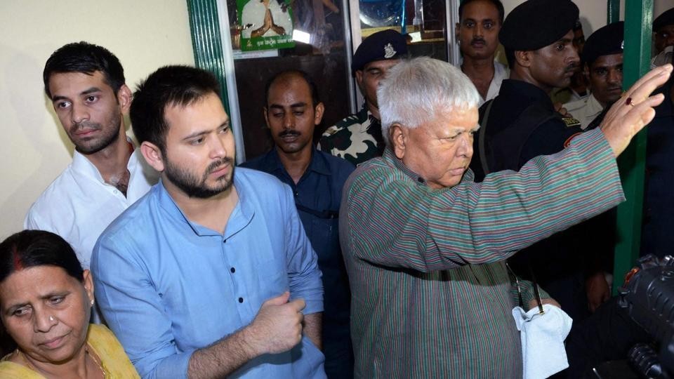 RJD chief Lalu Prasad with his wife Rabri Devi, son and deputy CM Tejashwi Yadav and Tej Pratap Yadav at a press conference at his residence in Patna on Friday after CBI raids at his premises.