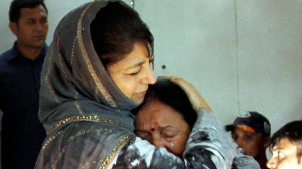 Jammu and Kashmir chief minister Mehbooba Mufti consoles an Amarnath pilgrim who survived a militant attack on their bus at Anantnag earlier this week.