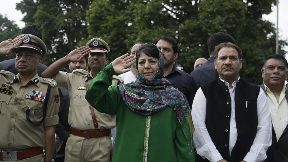 Jammu and Kashmir state Chief Minister Mehbooba Mufti pays homage at Martyr's graveyard in Srinagar. July 13 is observed as Martyrs' Day in memory of the day when the region s Hindu king ordered more than 20 Kashmiri Muslims executed in a bid to put down an uprising in 1931. (Mukhtar Khan / AP)