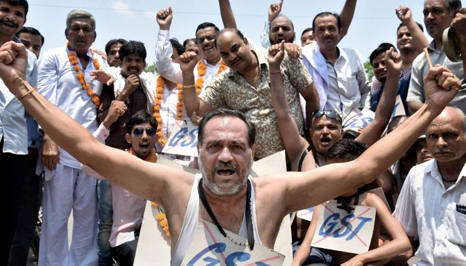 Cloth traders protest against the Goods and Services Tax (GST) at district collector's office in Bikaner on Saturday.