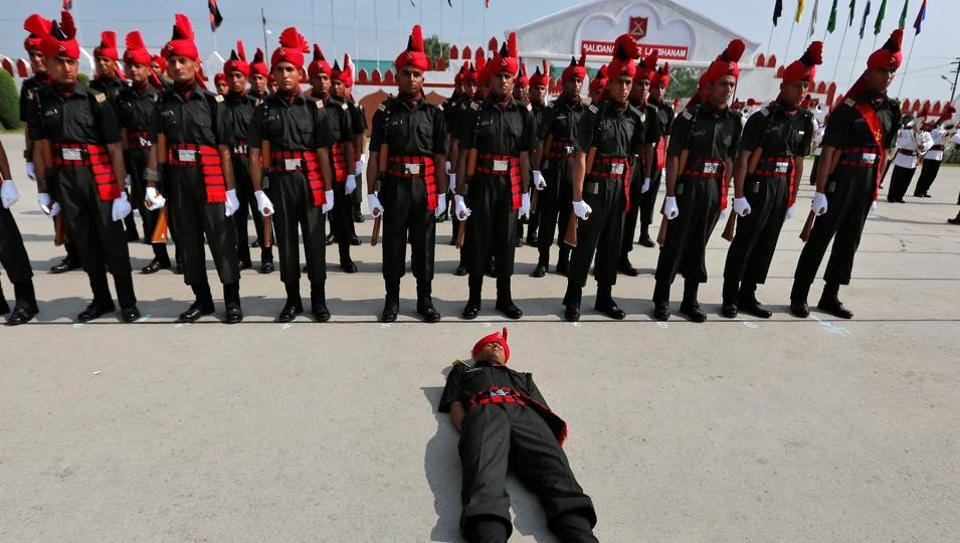 An Indian army recruit faints during a passing out parade at a garrison in Rangreth on the outskirts of Srinagar. (Danish Ismail /  REUTERS)