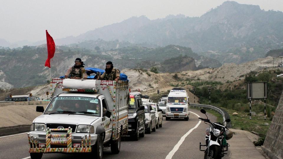 A security vehicle escorts a  group of Amarnath pilgrims, on way to the holy shrine, at Jammu-Srinagar national highway.
