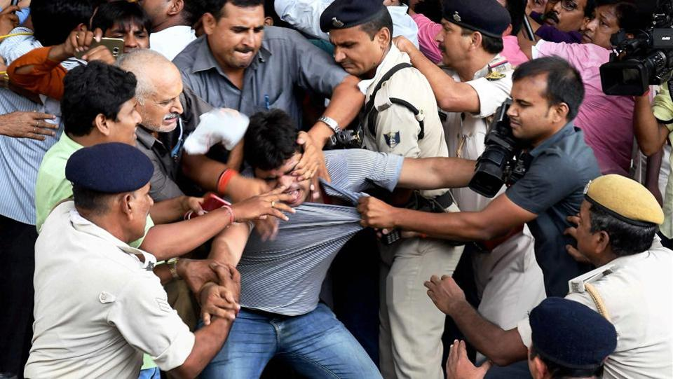 Bihar Deputy Chief Minister Tejashwi Yadav's security personnel clash with a media persons in Patna. (PTI)