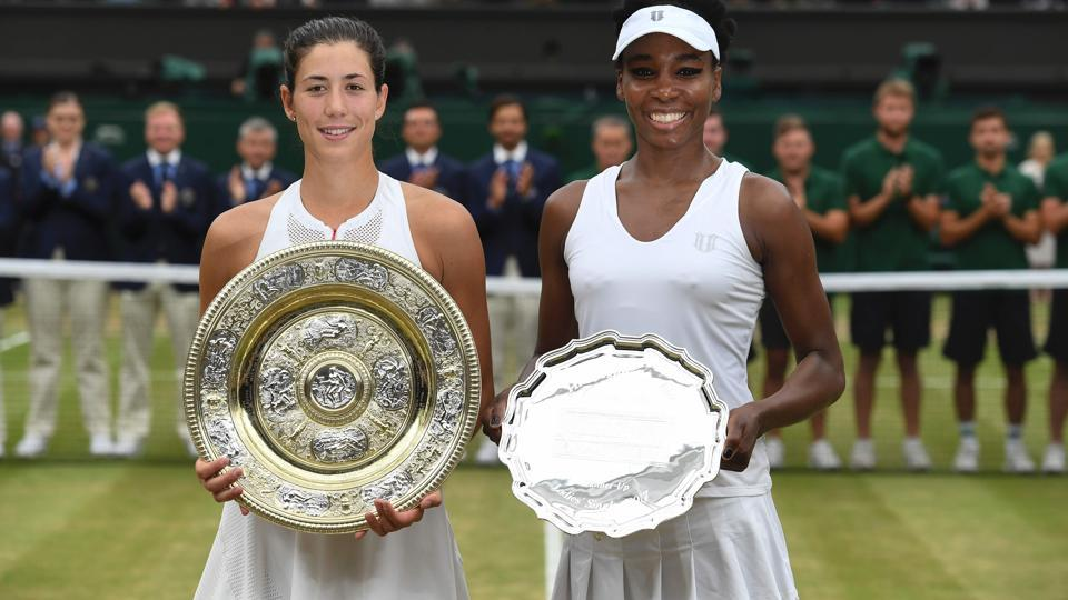 Garbine Muguruza (L) won her maiden Wimbledon title on Saturday while Venus Williams had to be content with the runners-up spot. (AFP)