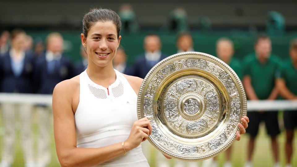 Spain's Garbine Muguruza poses with the trophy as she celebrates winning the Wimbledon 2017 final against Venus Williams.