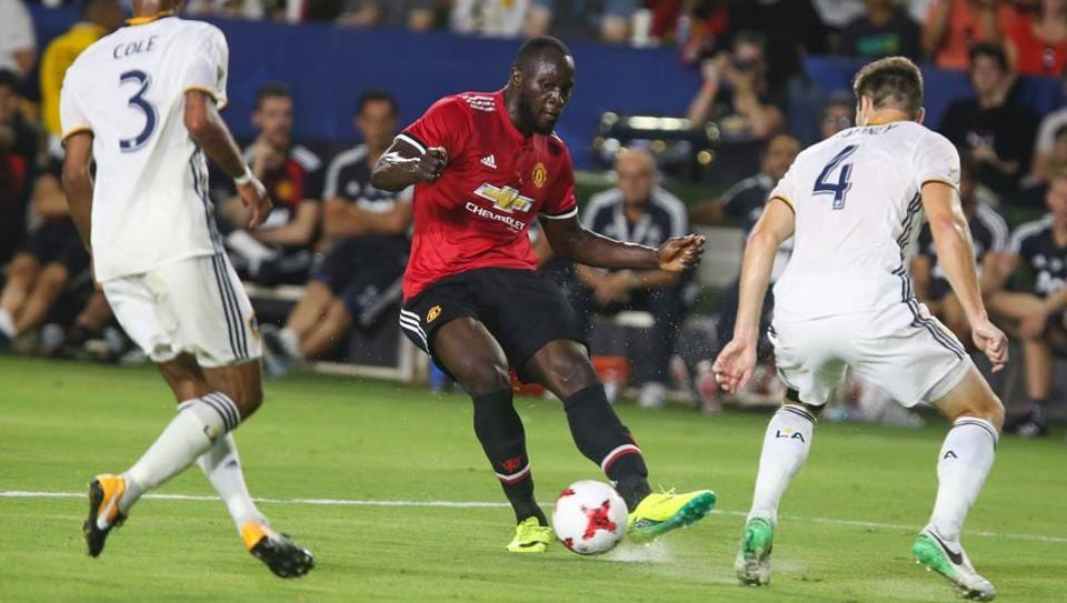 Manchester United's Romelu Lukaku (C) in action against Los Angeles Galaxy during a friendly match.