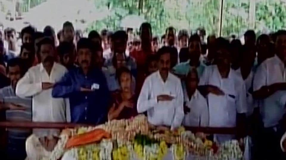 People attend the funeral of RSS worker Sarath Madivala, who was stabbed on July 4.