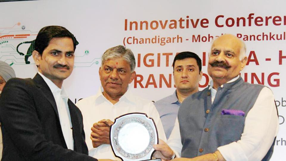Punjab governor V P Singh felicitating  Imran Khan at a Digital India event in Chandigarh last month.