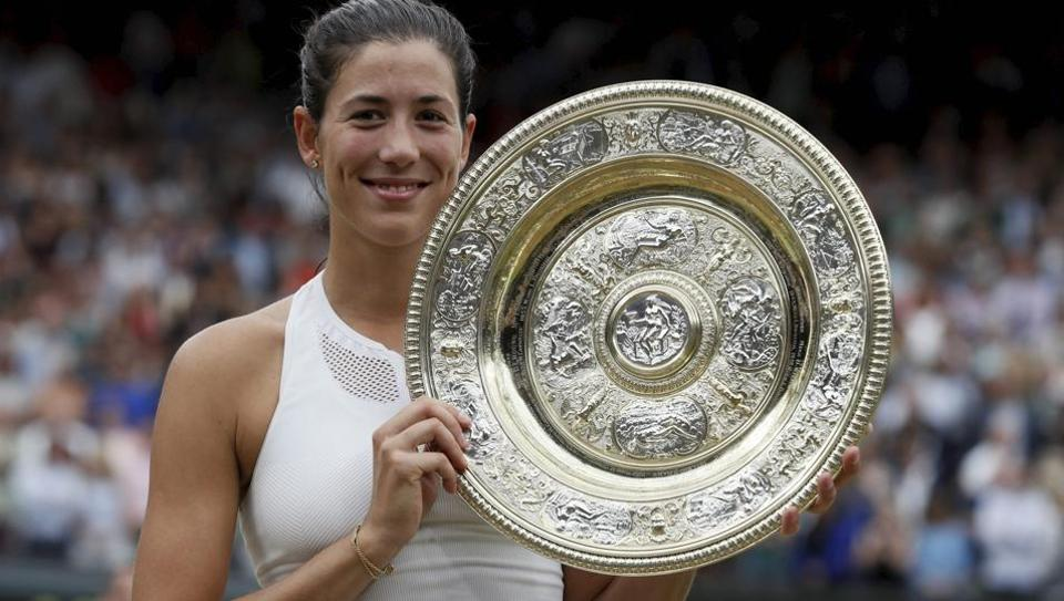 Garbine Muguruza holds the trophy after defeating Venus Williams in the women's singles final of Wimbledon.