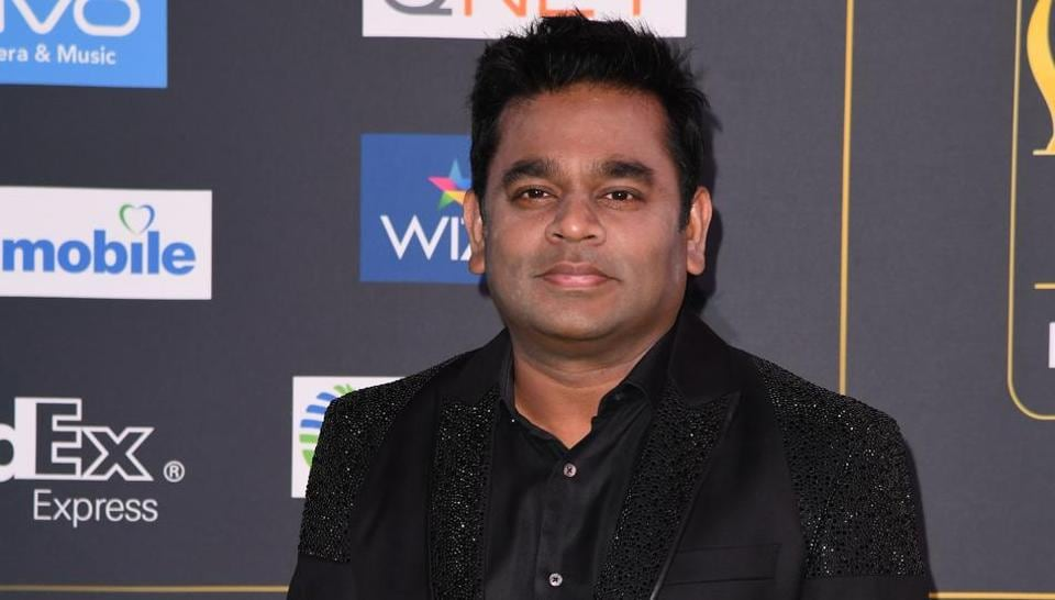 Bollywood music composer and singer AR Rahman arrive for the IIFA Awards.