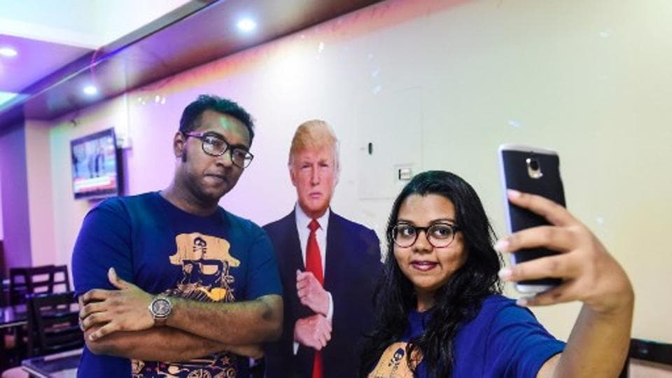 Bangladeshi customers take a selfie with a cutout US President Donald Trump at the Trump Cafe in Dhaka.