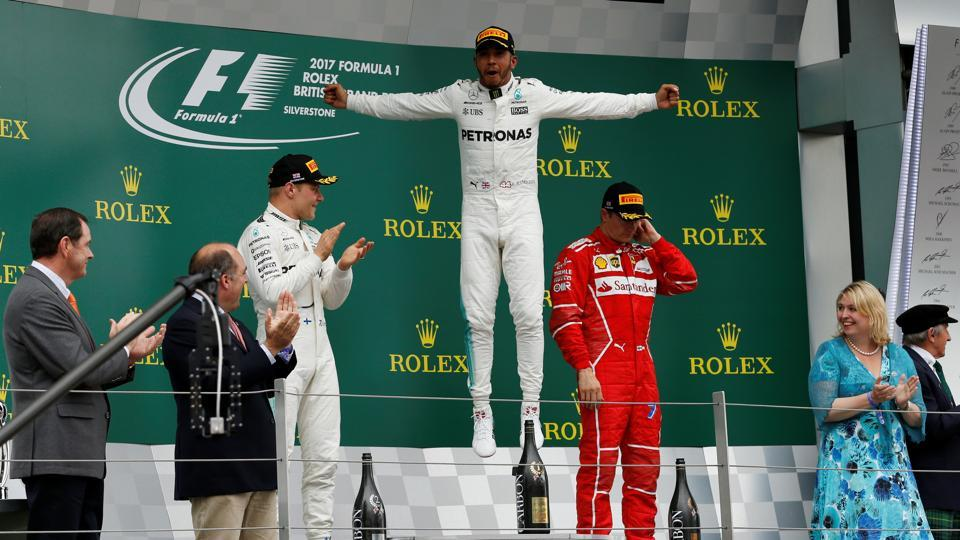 Mercedes' Lewis Hamilton celebrates his win in the Formula One British Grand Prixwith teammate Valtteri Bottas and Ferrari's Kimi Raikkonen.