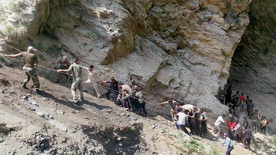 Security personnel carry out rescue work after a bus carrying Amarnath pilgrims fell into gorge off Jammu-Srinagar National Highway in Ramban district.