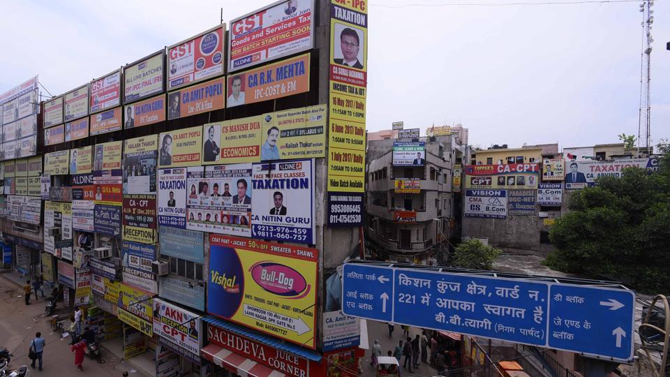 Hoardings invite people to enrol in GST classes in Laxmi Nagar area of New Delhi.