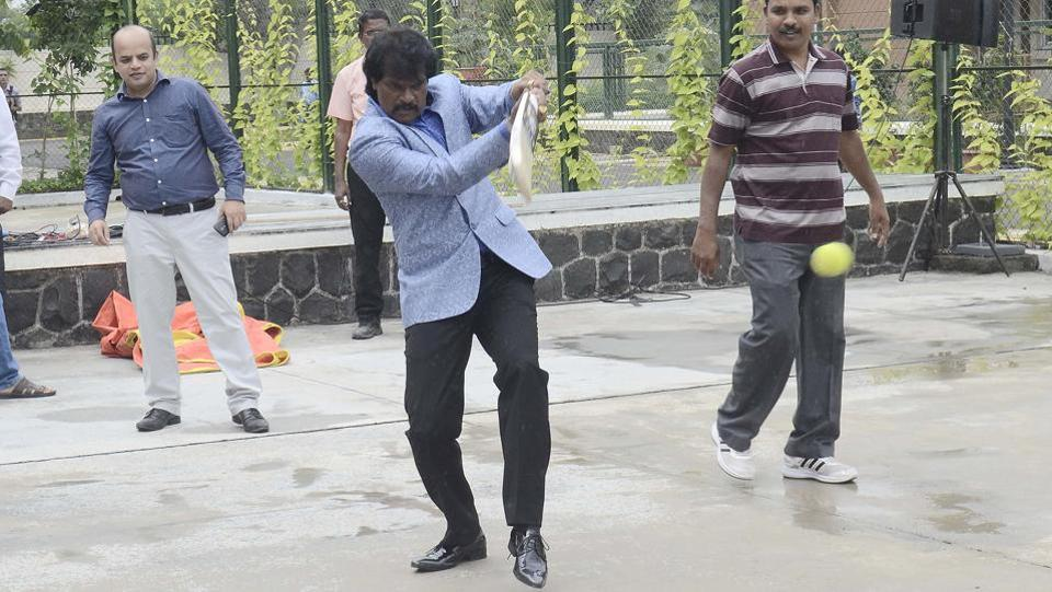 Former Indian Hockey Captain Danraj Pillay plays cricket at the skills festival organised by Symbiosis on Saturday.