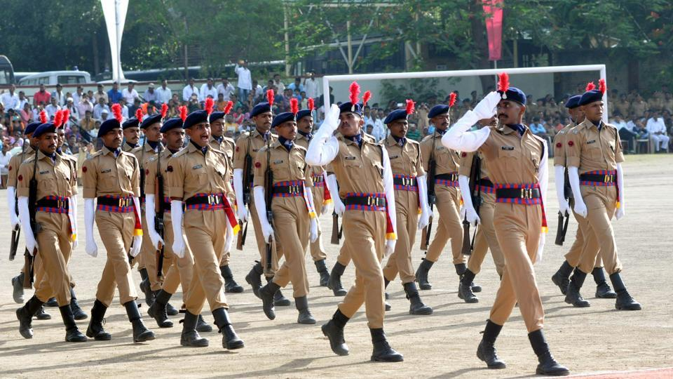 SRPF cadets salute the guests on the podium during passing out parade in Pune. (HT PHOTO)