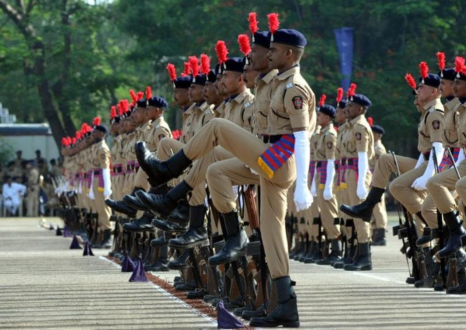 SRPF cadets marching in formation during passing out parade in Pune.  (HT PHOTO)