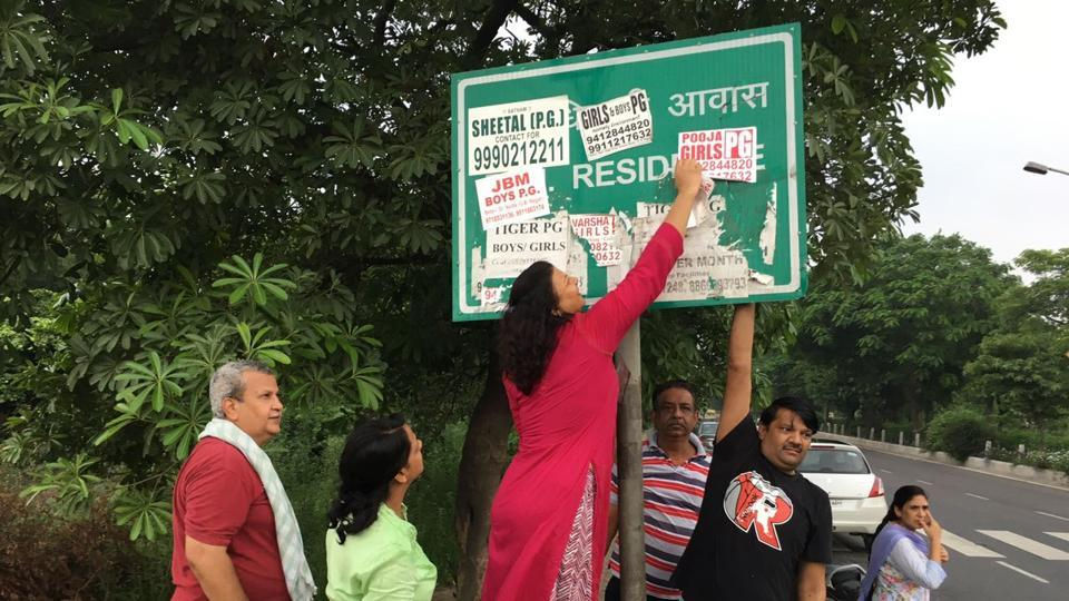 Many signboards and direction boards in the city are covered with posters and banners.
