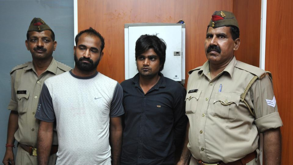 Police arrested Pradeep Bhati and Amir (second and third from left) for the murder of Pradeep's cousin Sajan Bhati in Salarpur village.