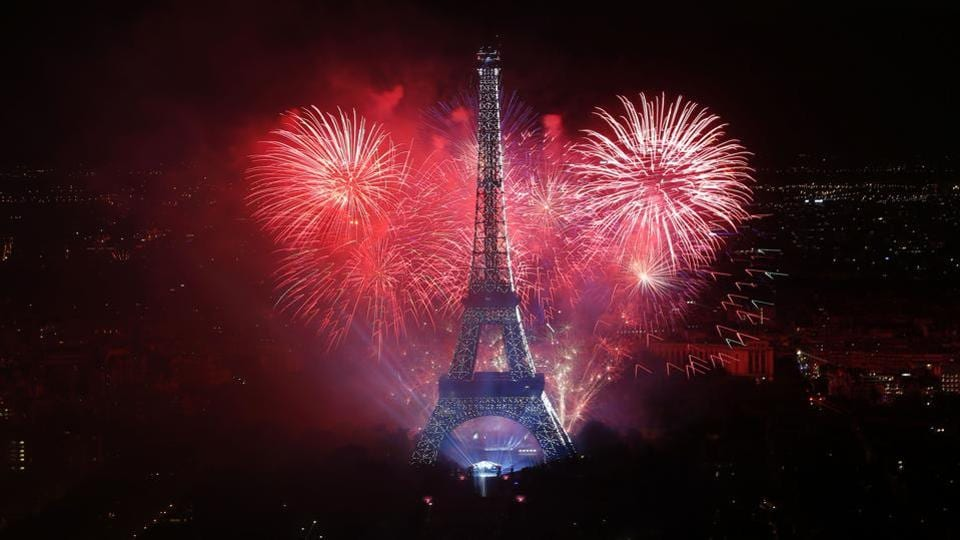Fireworks light the sky above the Eiffel Tower in the French capital Paris as part of France's annual Bastille Day celebrations as seen from the Panoramic Observatory of the Montparnasse Tower. (AFP)