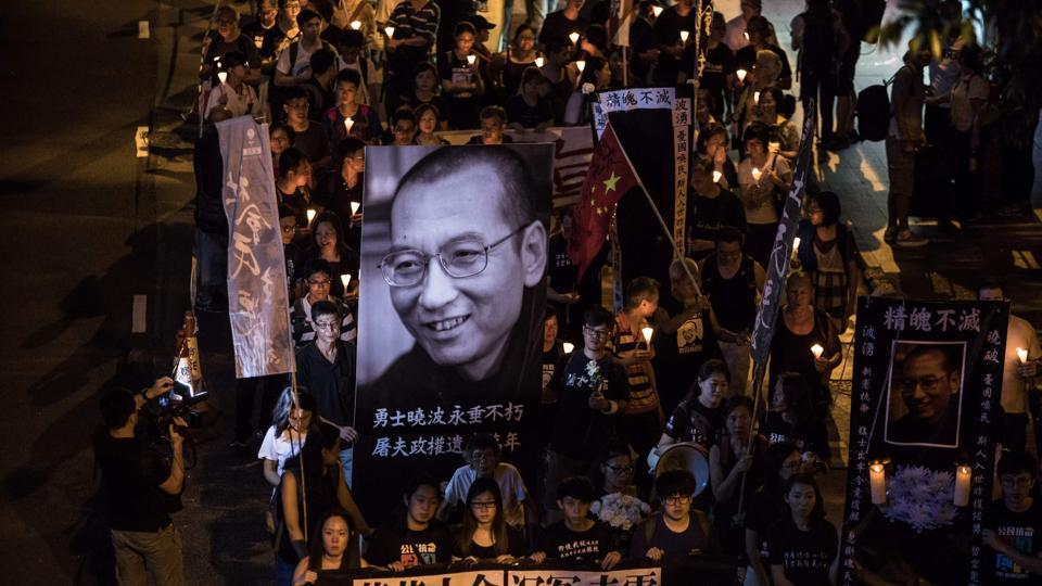 People attend a candle-light march for the late Chinese Nobel laureate Liu Xiaobo in Hong Kong on July 15, 2017. Liu died on July 13 after a battle with cancer, remaining in custody until the end as officials rebuffed international pleas to let the prominent dissident receive treatment abroad. (DALE DE LA REY/AFP)