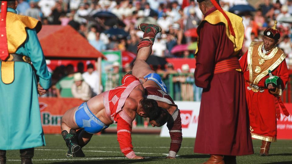 Mongolian wrestlers fight during the traditional Nadaam festival in Ulan Bator. (AFP)