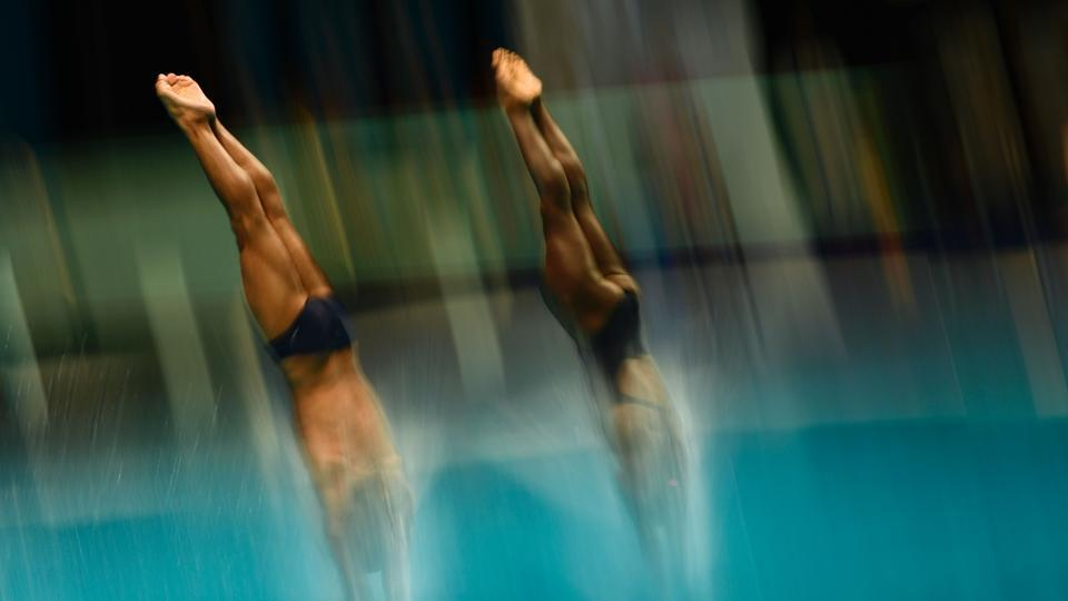 Cuba's Tuti Garcia Navarro and Cuba's Jeinkler Aguirre Manso compete in the Mixed 10m Synchro Platform final during the diving competition at the 2017 FINA World Championships in Budapest, on July 15, 2017. (Christophe Simon/AFP)