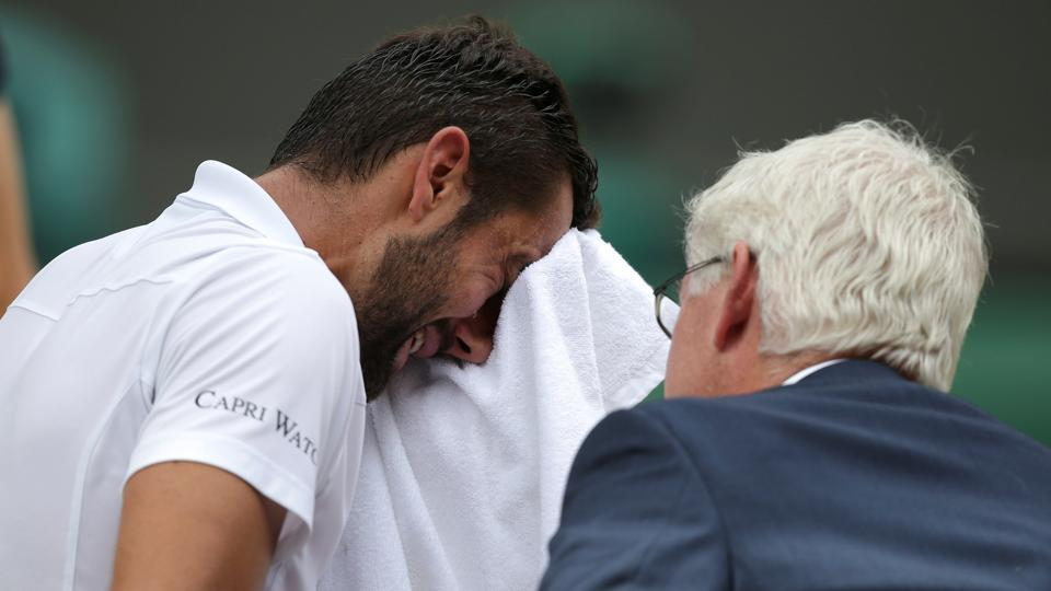 Marin Cilic was in severe pain and had his foot taped up before the third set began.  (REUTERS)