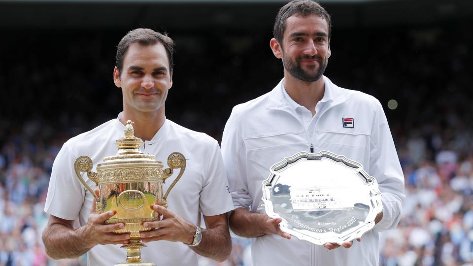 This win gave Roger Federer his eighth Wimbledon title and his nineteenth Grand Slam title.  (REUTERS)