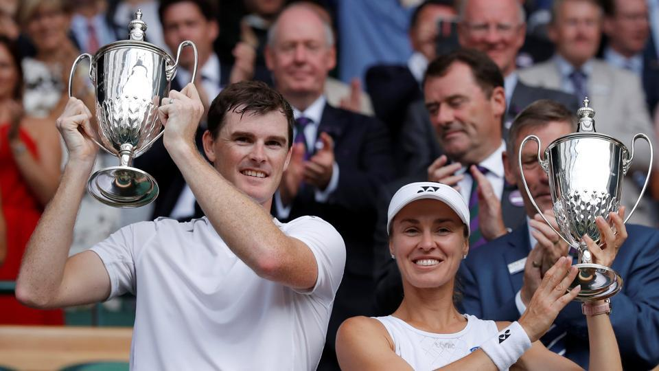 Jamie Murray and Martina Hingis pose as they celebrate with their trophies after winning the Wimbledon mixed doubles final.