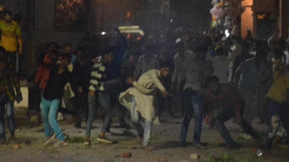 Six persons were injured in stone pelting during a clash over ownership of a disputed land near a mosque in Varanasi on Sunday night.