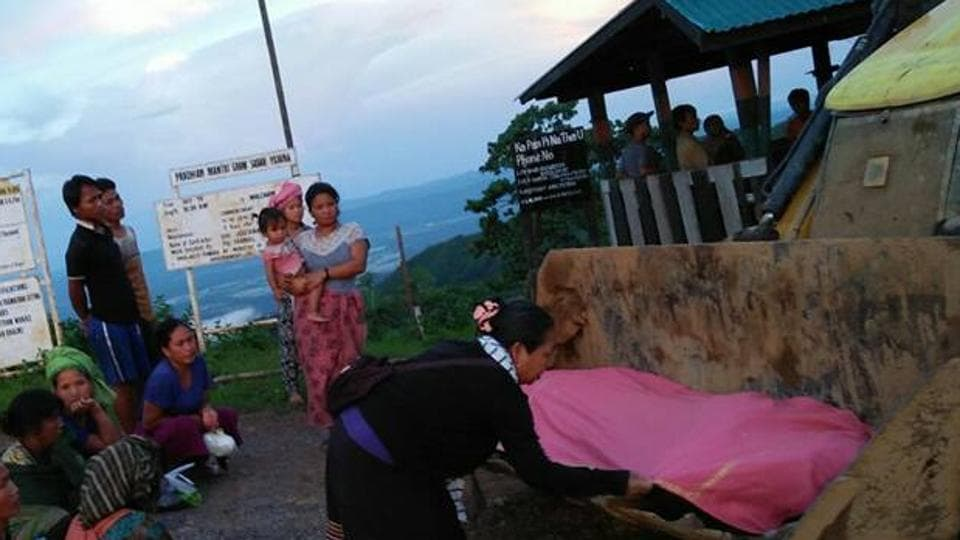 An excavator was turned into an ambulance to  carry 40-year-old Thangtinlen Baite to a nearby hospital in neighbouring Myanmar.