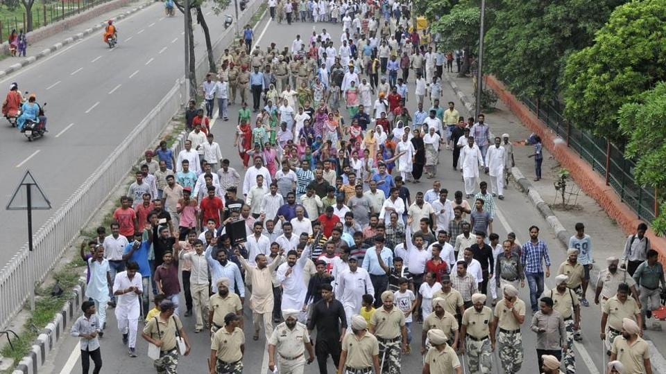 Protesters marching towards the Jalandhar Bypass against the killing of a pastor outside a church at Salem Tabri, in Ludhiana.