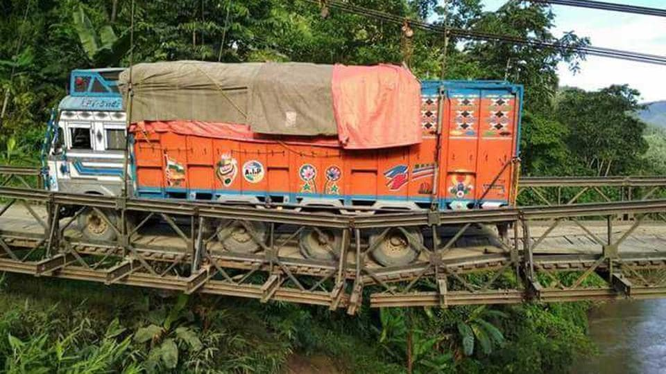 British era steel bridge across river Barak on a national highway collapsed partially in Manipur.