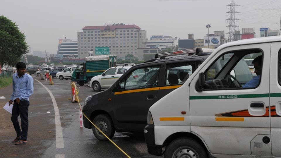 Vehicles moving from Delhi to Gurgaon get stuck in jams near the Dhanchiri camp where the tax is collected.