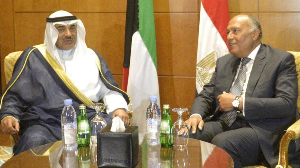 Kuwaiti Foreign Minister, Sheikh Sabah al-Khaled al-Sabah (L) speaks with his Egyptian counterpart Sameh Shoukry during a meeting in the capital Cairo, on July 17, 2017.